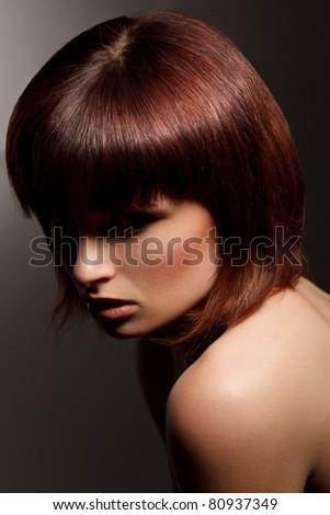 Brown Hair. Beautiful Woman with Healthy Short  Hair. High quality image - stock photo