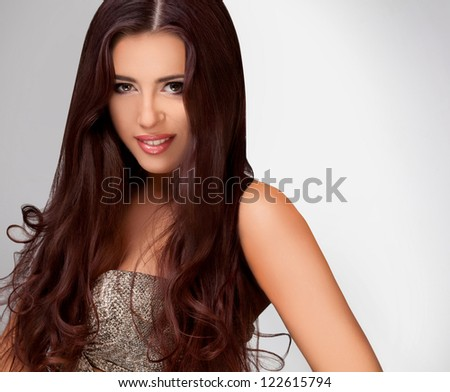 Brown Hair. Beautiful Woman with smooth Long Hair. High quality image. - stock photo