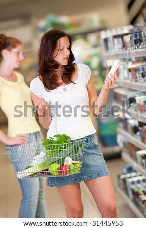 Brown hair young woman in a supermarket