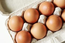 brown hen eggs in carton box