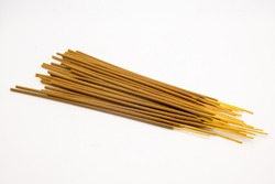 Brown indian incense aroma sticks isolated on white background close up. Set of buddhist incense stick for meditation top view