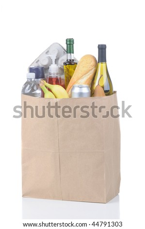 Brown Kraft Paper Bag full of assorted groceries isolated over white vertical format with reflection - stock photo