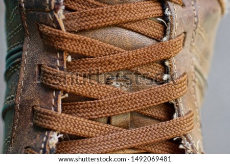 brown lace-up fabric lacing on leather boot #1492069481
