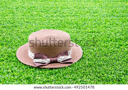 Brown ladies hat on turf texture background with copy space. #492501478