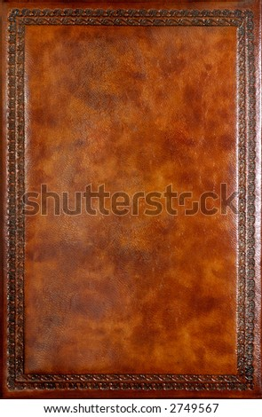 Brown leather book cover with decorative pattern
