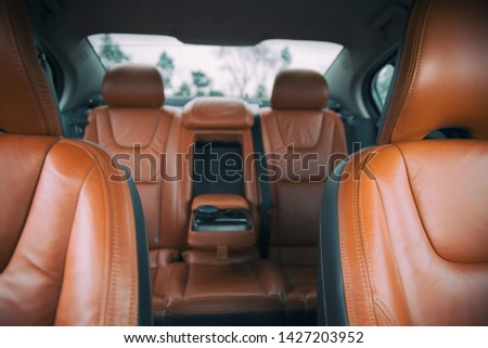 brown leather furnished luxury car interior #1427203952