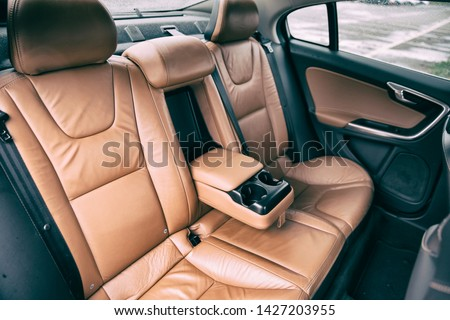brown leather furnished luxury car interior #1427203955