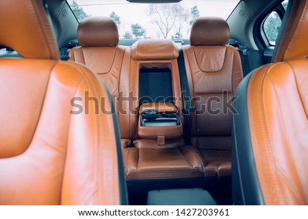brown leather furnished luxury car interior #1427203961