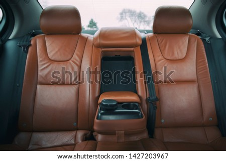 brown leather furnished luxury car interior #1427203967