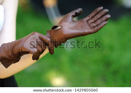 brown leather gloves on women's hands Stock photo ©