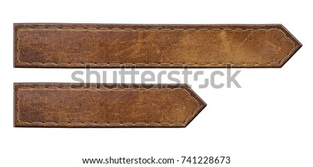 Brown leather jeans labels. Isolated long arrow shape leather tags.
