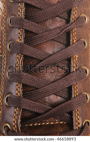 Brown leather shoe laces in close-up