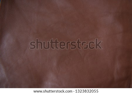 Brown leather texture. Brown fabric background. Brown leather background