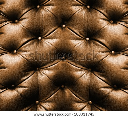 brown leather texture of sofa closeup shot