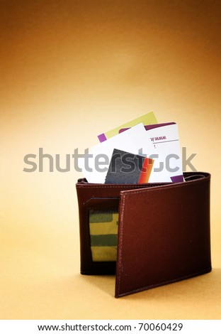 Brown leather wallet isolated on yellow