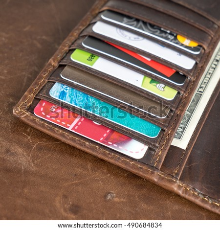 Brown leather wallet with money, credit and discount cards #490684834