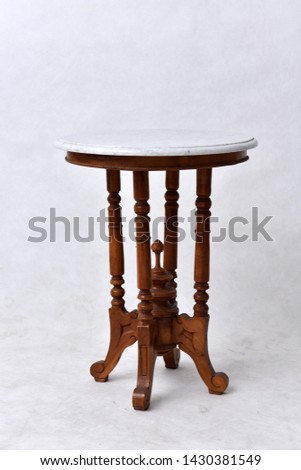 Brown, light brown wooden round dining table. Modern designer, dining table isolated on white background. Series of furniture. #1430381549