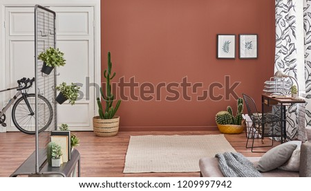 Brown living room wall and background decorative corner room and white classic pattern door. Frame lamp and sofa decoration.