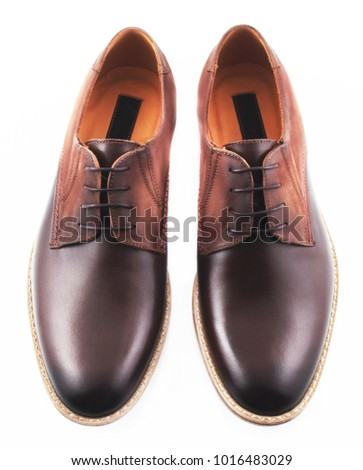 Brown men's leather shoes isolated on white background #1016483029