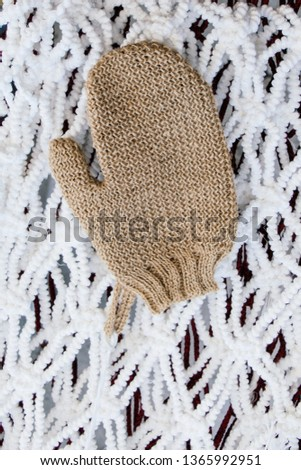 Brown mitten on a white background in the view #1365992951