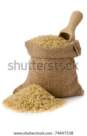 Brown natural long rice in small burlap sack