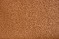 Brown natural or genuine leather texture for background. Saffiano leather.