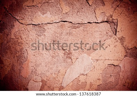 Brown old cracked paint texture damaged wall abstract, broken paint surface abstract of brown tinted background with dark vignette in horizontal orientation, nobody.