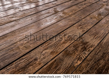 Brown on the veranda floorboards close up as background. #769571815