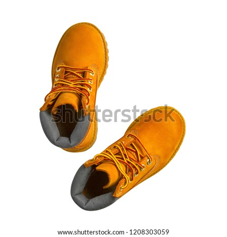 brown or yellow boots shoes for foot and adventure travel or keep walking journey with trekking on floor or ground and top view isolated on white included clipping path #1208303059