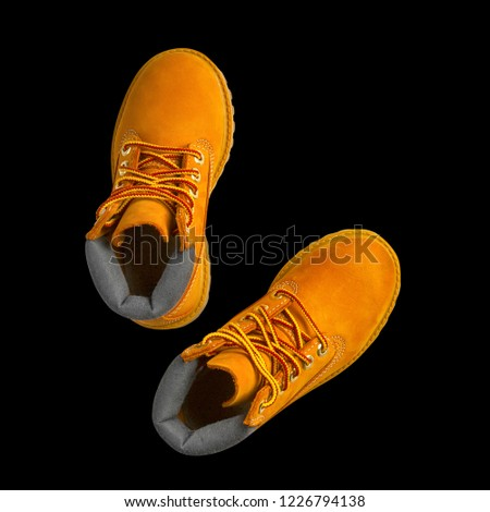 brown or yellow boots shoes for foot and adventure travel or keep walking journey with trekking on floor or ground and top view isolated on black background included clipping path #1226794138