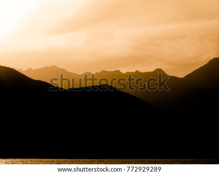 brown outline of black mountains magnificent natural scenery view