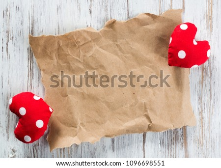 Brown package paper and love hearts on wooden background #1096698551