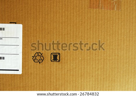 Brown packaging cardboard background with a recycle symbol