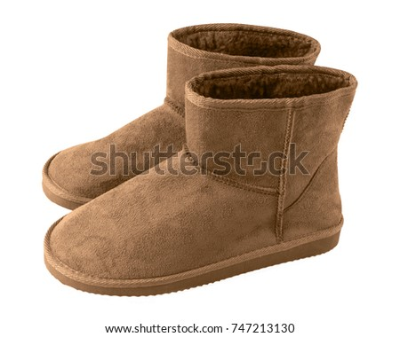 Brown pair of short winter u g g boots isolated white #747213130