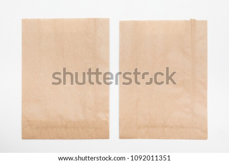 brown paper bag for bread on white background