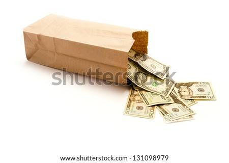 Brown paper bag with United States twenty dollar bills coming out of it for concepts money laundering,c rime, drug dealing, mafia, bribe payoffs, cash business