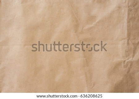 Brown paper crumpled texture and background with space.