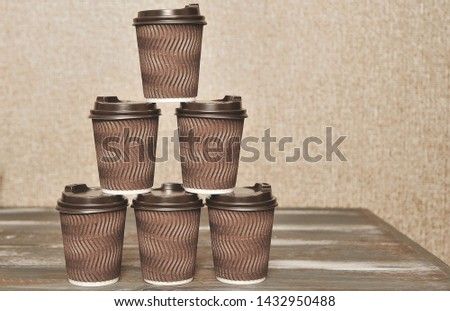 Brown paper cups for coffee on wooden background. #1432950488