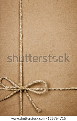 Brown paper gift package background with twine and copy space
