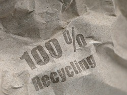 brown paper packing material made of one hundred percent recycled paper with print 100 percent Recycling.