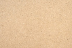 Brown paper texture background from a paper box packaging. Paper cardboard background concept