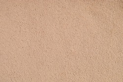 Brown pebble wash rough wall surface.  An earth tone color and touch make a blend in nature habitat. A minimal and zen mood image for background and wallpaper.