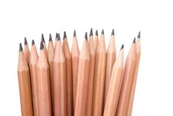 Brown pencils on white background. Creative placement of lots of pencils together in a group.
