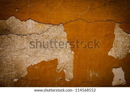 Brown plaster damaged grunge background texture wall