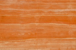 Brown Rammed earth wall grunge texture background. Compacted clay wall with layers of different colored incorporation striations of natural earth tone colors creates a warm, nature-friendly atmosphere