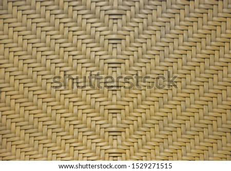 brown rattan woven in arrows pattern texture for background.