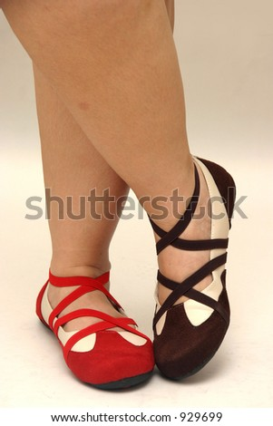 Brown & red dance shoes striking a pose on dancing feet