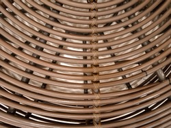 Brown red real walnut wooden furniture panel round circle spiral pattern fractal background. Furniture wall decoration element. Wooden decoration element fractal background. Spiral fractal pattern