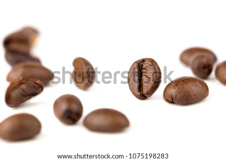 Brown roasted coffee beans falling , Represent breakfast, energy, freshness or great aroma,white background and bright wallpaper concept.close-up blur odject #1075198283