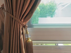 brown roman blind shade curtain tree forest mountain background living room.